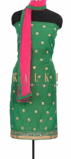 Buy this  Sea green unstitched suit adorn in zari butti only on Kalki