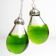 Want! Earrings. Hand blown glass filled with coloured water. I wonder if they get funky after a while? $28 #jewelry