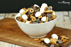 This S'mores Snack Mix is the perfect lunchbox snack.  It's easy to make and kids love it! It might be time to go back to school, but it's still technically summer around here.  And, nothing says summer like s'mores! I thought it would be fun to make a lunchbox snack that tastes just like our … … Continue reading →