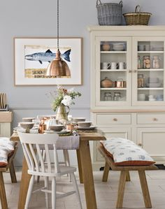 Copper elements throughout this room and a seaside-themed piece of art give this space charming nautical feel