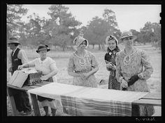 Farm women getting dinner ready at the all-day community sing. Pie Town, New Mexico
