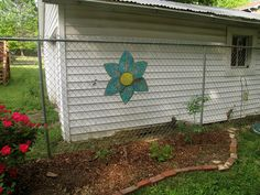 More garden art DIY fun!  A sheet metal flower to hang on the fence