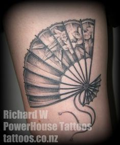"""Fan Tattoo I found on a random search, love that the flowers on the fan are more """"blended"""" a lot of other's I've seen just have flowers added across them rather than look like they are part of the fan, great crisp lines too!"""