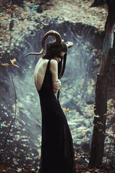 Draped black dress, dark nature photo, love the look of this.