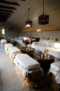 """What a great idea for a """"barn"""" party! Use quilts for casual, simple white covers…"""