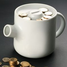 teapot coin bank--the spout allows you to pour as many coins as you need.  a new approach to a classic object.