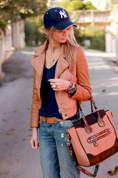Brown leather jacket= cute twist and more feminine