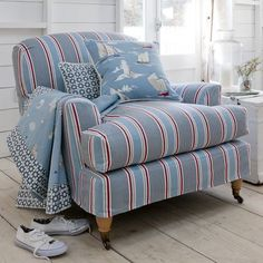 DesignNashville, authorized dealer of designer fabrics. This chair: Clarke and Clarke - Maritime Prints Fabric Collection - Blue and red striped fabric armchair with boat printed cushion