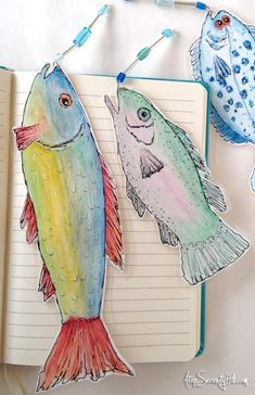 Watercolor and doodled fish bookmarks with beaded lures; laminated for added protection • AtopSerenityHill.com #bookmarks #fishing #watercolor