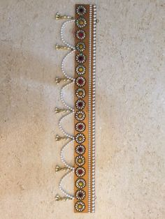 Handcrafted Bandhanwar On wood with tiny bead hanging This will add style and give your home an Indian touch this Diwali. Home decor gifts