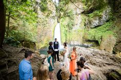 simple and remote Northwest forest ceremony with waterfall in background @myweddingdotcom