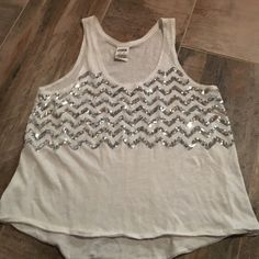 PINK sequin tank top white flowy tank top, with silver chevron sequin pattern. Size XS in great condition PINK Victoria's Secret Tops Tank Tops