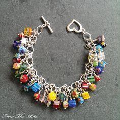 Millefiori charm bracelet #millefiori #charms #beads #multicolour #charmbracelet #bracelet #fromtheattic #handmade #madeinuk #etsy #fashion #accessories #giftsforher #jewellery #jewelry