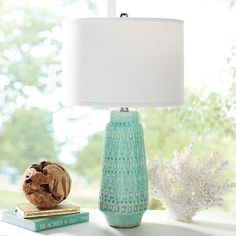 Blue is trending everywhere in home decoration in 2016, and the Coco Table Lamp is an easy way to explore adding more of this fresh, tranquil color to your own living spaces. The ceramic base is delicately patterned, delivering the tones with more interest and a fashion-right touch of retro cool. This particular hue is a good choice for a modern room, or updating your otherwise natural, neutral, or traditional living areas, from bedrooms to living rooms. The drum style lampshade pops crisply…