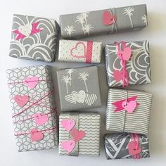 H E A R T'S D E S I R E Swooning for these pink-on-grey gift wrappings.