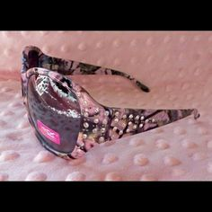 cc99922142a3 Pink Camo Sunglasses Pink rhinestone camouflage sunglasses. Polycarbonate  shatterproof lens. UV 400 protection. Accessories Glasses