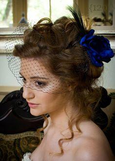Dark blue flower fascinator with birdcage veil