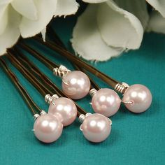 Put the final touch on your hairstyle with elegant pink pearls. #hair #accessories