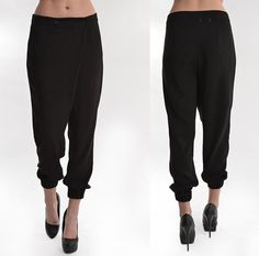 Solid black high-waist harem pant with pockets and asymmetrical button closure. Fits true to size. $38.00