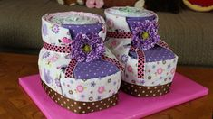 Diaper booties! omg these are cute! all you need are 4 receiving blankets per boot, diapers and ribbon
