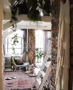 This dreamy peek into the doorway of a boho paradise--this is pure magic from the inspired feed of @thelifetraveller and is our feature for #BohoisMyJam this week. . Plants cascading down. Dreamy light. Vibrant pattern courtesy of Kuba cloth. Brick wall with the soft gauzy fabric--ahh the juxtaposition of textures. . . Manon @thelifetraveller has captured the inherent romance of bohemian interiors and I'm thrilled to follow along. She also has a shop where she sells gorgeous wares from…