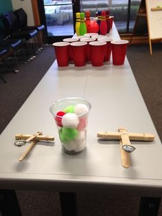 Angry Birds program setup! Kids got to learn about catapults, then fly their pom poms into the cups.: