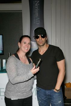 Magician Criss Angel (R) poses with NeriumAD. (Photo by Gabe Ginsberg Getty Images for Nerium International) 2014 Getty Images   www.dkrotondo.theneriumlook.com