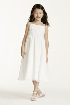 Spaghetti strap chiffon baby doll empire waist with pleated detail & beaded embellishment. T-length chiffon skirt.   Available in stores and online in Ivory. White only available online or by Special Order.  Coordinates with David's Bridal Gown Style V9743.  Also available in plus size flower girl sizes 8+-14+, Style FG9743+,