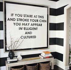Foyer, humorous print. Love the striped walls.