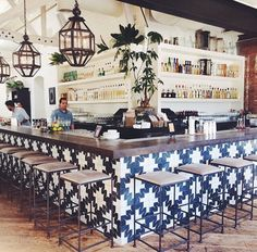Graphic tile around the island + plants soften hard edges Graphic tiles around the island + plants s Cafe Bar, Cafe Restaurant, Mexican Restaurant Design, Bar Interior, Restaurant Interior Design, Commercial Design, Commercial Interiors, Cafe Design, House Design
