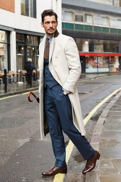 David Gandy, model Wearing a David Gandy design overcoat and suit tailored by Neil Fennell, Eton shirt, Drakes tie and Russell and Bromley shoes. Photo by Dvora for GQ UK David Gandy Style, David James Gandy, Gentleman Mode, Gentleman Style, Mode Masculine, Sharp Dressed Man, Well Dressed Men, Look Formal, Dolce E Gabbana