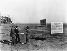 (1922) - Three men with plans in hand examine the area to become Santa Monica Boulevard. Taken in 1922, the photo also shows a billboard announcing Westwood, now open, by Janss Investment Co.