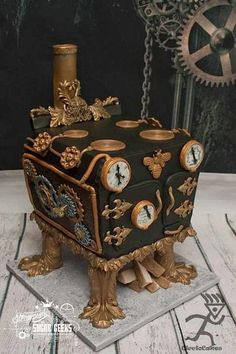 Cake Wrecks - Home - Sunday Sweets: Geek Chic Wedding Cakes. A cake shaped like a steampunk oven. It has feet, and three dials in sort of a face shape, so I thought it might be a very stylized steampunk cat. Gorgeous Cakes, Pretty Cakes, Amazing Cakes, Cake Wrecks, Unique Cakes, Creative Cakes, Steampunk Wedding Cake, Gothic Cake, Fashion Cakes
