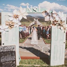 A Colorado ranch wedding with a gorgeous paper flower ceremony backdrop! Bailee these DIY flowers are so pretty!!