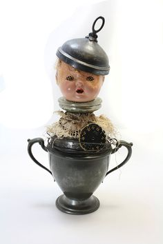 Found Object Folk Art Doll Assemblage  The by CuriousCrowArt, $150.00 Baby doll face, tea pot, clock, lace, tin. Sold to public.