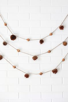 Paper Leaf Garland— print the template to make your own! Pinecone Garland, Fall Garland, Beaded Garland, Garland Ideas, Pinecone Decor, Pine Cone Decorations, Festival Decorations, Diy Thanksgiving, Thanksgiving Decorations