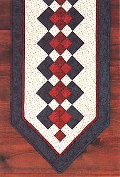 Image from http://quiltbug.com/images/patterns/seminole-table-runner.jpg.