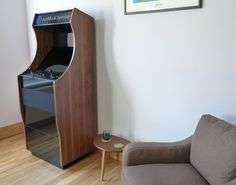 Retrograde arcade cabinet with walnut sides and black gloss paintwork.