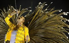 A performer from the Mocidade Independente de Padre Miguel samba school sings on a float during carnival celebrations at the Sambadrome in Rio de Janeiro