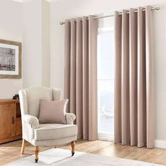 Crafted from a linen blend fabric for a textured finish and available in a range of widths and drop lengths, these eyelet curtains in a biscuit shade of brown a...