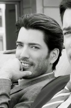 """Jonathan Silver Scott, Canadian designer- contractor, actor-producer & the 'builder' half of HGTV's """"Property Brothers"""" home reno team. Drew Scott's right eye & tie are visible just to the right of Jonathan."""