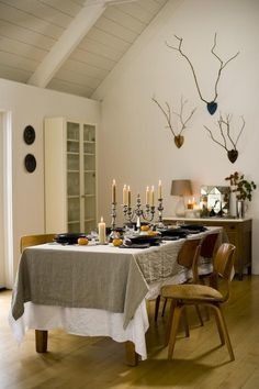 """There are so many things about this room I love, to begin the linens and the branch """"antlers""""...."""