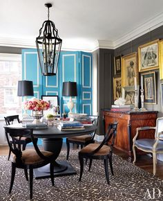 A vintage folding screen adds a burst of color in the dining room of a Kansas City apartment. The pedestal dining table is by RH, and the drawings are by S. Pedestal Dining Table, Round Dining Table, Dining Chairs, Bistro Chairs, Round Tables, Dining Area, French Country Bedrooms, Architectural Digest, Dining Room Design