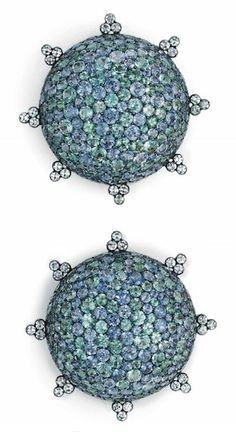 A PAIR OF MULTI-COLORED SAPPHIRE AND DIAMOND EAR CLIPS, BY JAR  Each designed as a pavé-set green and violet sapphire dome, to the single-cut diamond surround and border detail, mounted in silver and 18k gold, with French assay marks and maker's marks, in a JAR pink leather pouch Signed JAR, Paris
