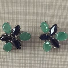 Elegant classy real emerald and blue sapphire ears This earrings is set in real sterling silver stamped 925 with a coat of white gold 11.32 k oval and marquise face cut stones stone dimension is 7x5 and 7 x 3.5 mm   Is beautiful piece of jewelry Jewelry Earrings