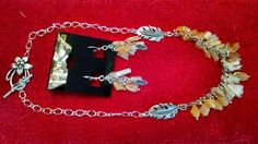 Beautiful and fun necklace and earring set made with Citrine stones & silver plated chain and charms.