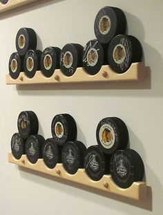 Hockey Puck Display Case Holder / Rack - would be nice for displaying my pucks. :)