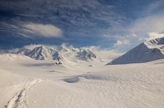 Out skiing on the Black Rapids Glacier in the Alaska Range on wind-packed snow. Taken in April 2013. This was during a short jaunt to replace the batteries in a timelapse camera and deploy a pressure sensor in what will soon be a lake at the start of our 2013 field season.