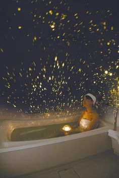 """The waterproof planetarium floats in water and contains a bright light that projects out into the room, or even into the tub itself when flipped over."" >> neato!"