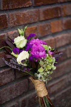 Purple bouquet, tan wrap for me. Bm's white peonies and blue dresses. Tables-plummy carnations.